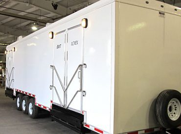 portable restroom trailers at the super bowl